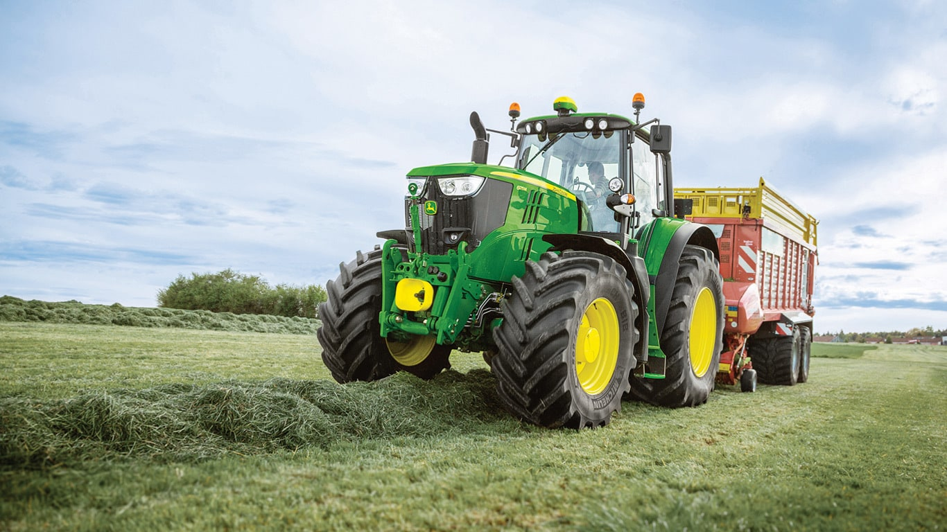 6M Series of mid size farm tractors by John Deere