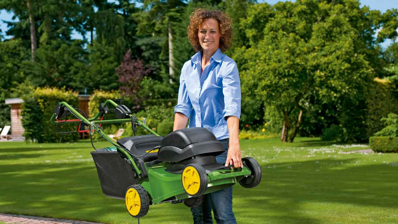 Woman lifts Walk-Behind Electric Mower R43EL