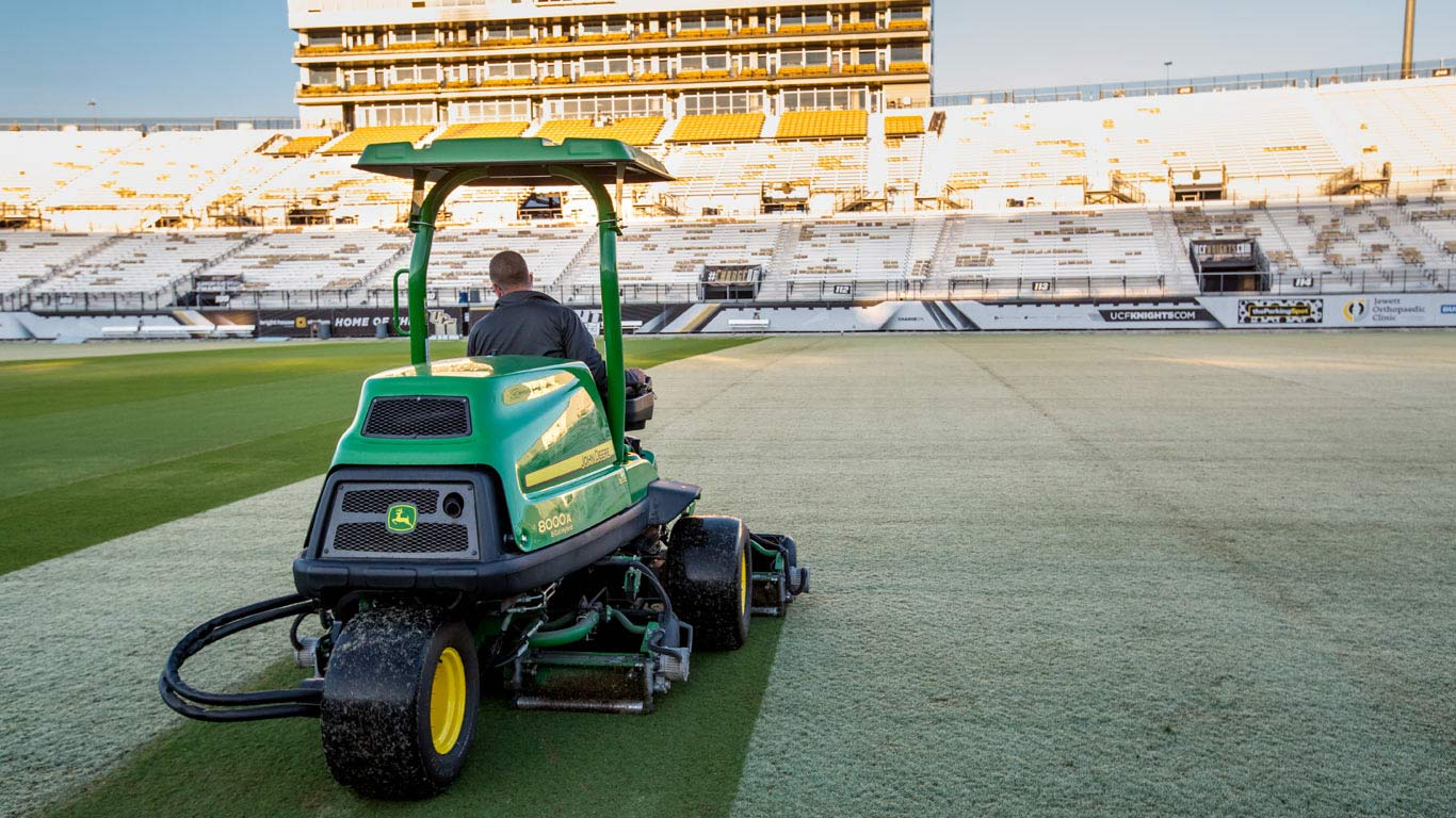 sports turf mower in stadium